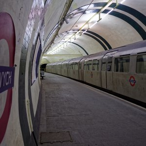 Platform with tube train inside disused Aldwych underground station in London.