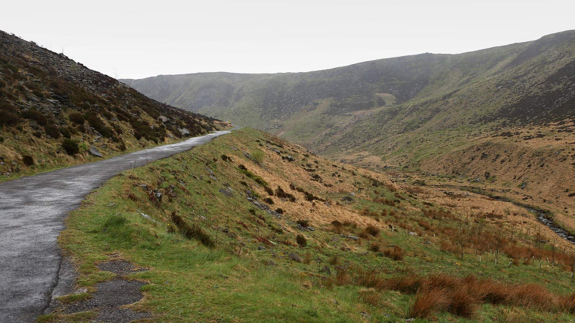 View of empty moors with road leading into the distance